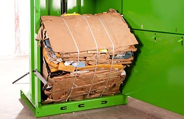 V8 baler compactor integrated kicker for easy bale removal